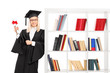 Female graduate leaning on a bookshelf