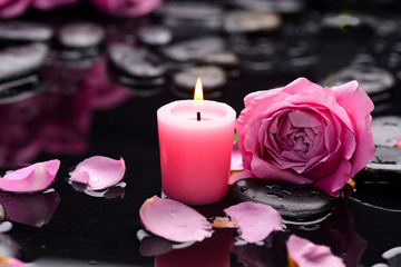 Beautiful rose ,petals orchid with candle and therapy stones