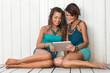 Smiling Girls Using Digital Tablet