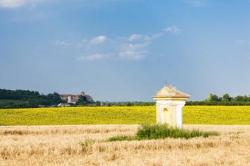 God's torture with sunflower field and Jaroslavice Castle, Czec