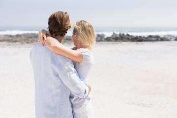 Cute couple hugging on the beach