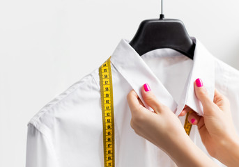 Woman tailoring business shirt