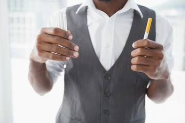 Casual businessman holding cigarettes