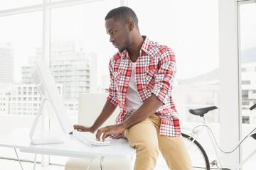 Focused casual businessman using computer