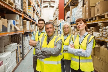 Warehouse team with arms crossed