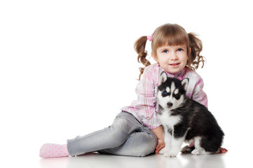 Girl with a puppy, isolated on white background