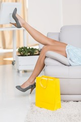 Woman kicking back after shopping