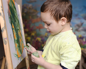 Child painting with colors