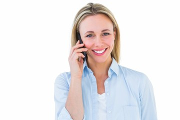 Pretty blonde smiling on the phone
