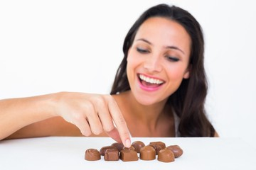 Pretty brunette picking out chocolate