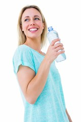 Smiling blonde holding bottle of water