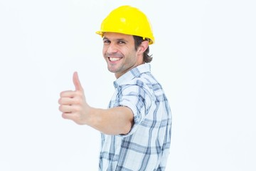 Happy technician gesturing thumbs up