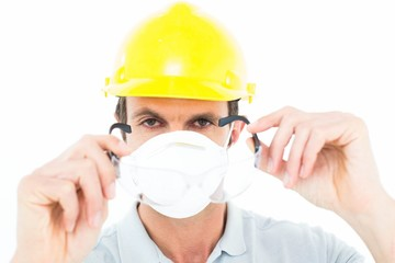 Worker wearing protective glasses over white background
