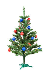 Christmas tree decorated red and blue balls on white background.