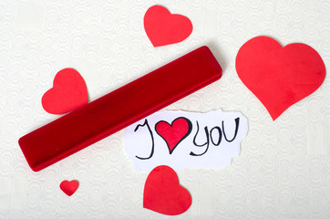 Valentine's Day, a red box with a gift decorated with hearts