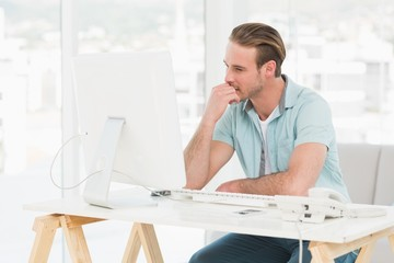 Concentrated businessman working with computer