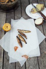 Fried smelt fish on white paper