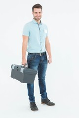 Confident male technician carrying toolbox