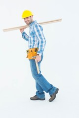 Smiling worker carrying wooden planks