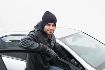 Car thief looking at camera