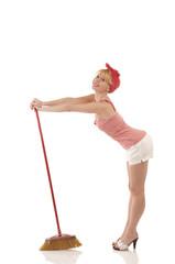 Cute woman with broom