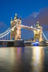 Tower Bridge at sunset & night twilight London, England, UK..