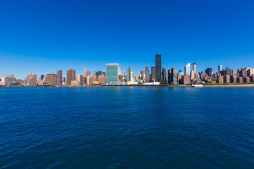 Manhattan New York sunny skyline East River NYC