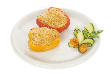 Red and Yellow stuffed peppers on dish isolated on white