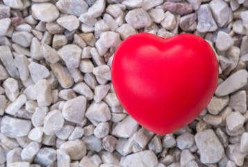 Red heart in love of Valentine's day with stone background.