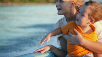Mother and son enjoying sea travel by boat