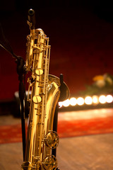 Baritone saxophone standing on stage