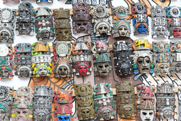 Mayan woodeMayan wooden handcrafted masks on the street market