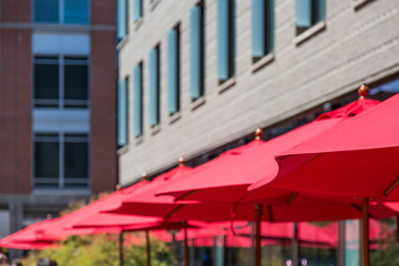 Red Umbrellas by Building