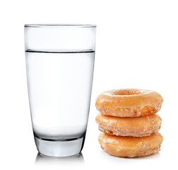 donut and glass of water isolated on over white background
