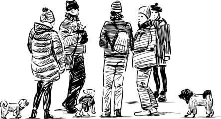 people with the dogs on a walk
