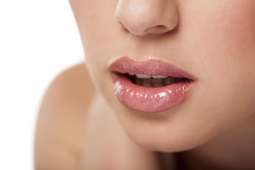 beautiful woman lips with lip gloss