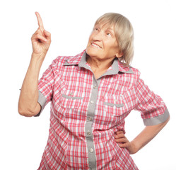 happy senior woman pointing upwards