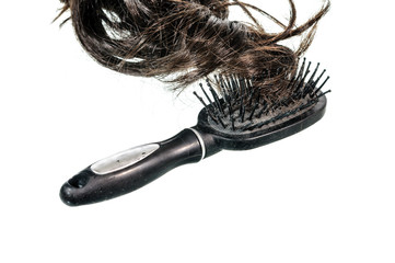 Old black comb with hairs