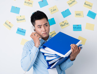 Businessman with stack of binders