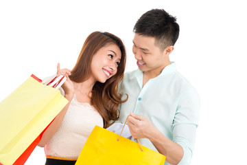 Loving couple with paper bags