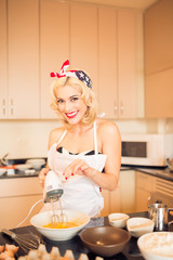 Housewife with a mixer