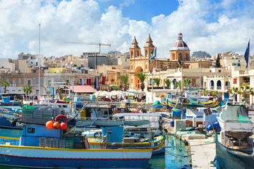 Fishing boats in Marsaxlokk harbour. Malta
