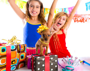 girl friends party dancing with presents and puppy