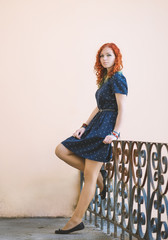 Portrait of a beautiful redhead girl. Color toned image.