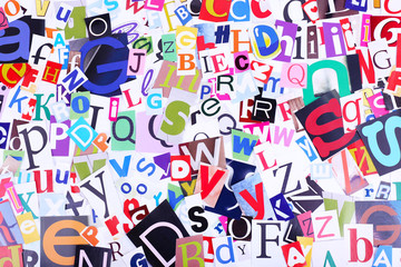 Colorful newspaper letters as background