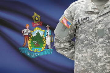 American soldier with US state flag on background - Maine