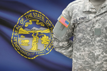 American soldier with US state flag on background - Nebraska