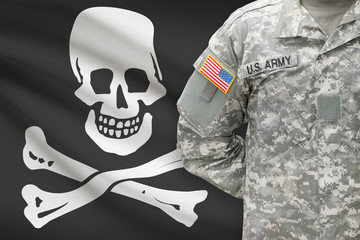 American soldier with flag on - Jolly Roger - symbol of piracy