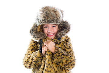 Blond winter kid girl cold freeze gesture and fur