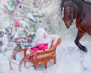 Little girl with horse at christmas eve.